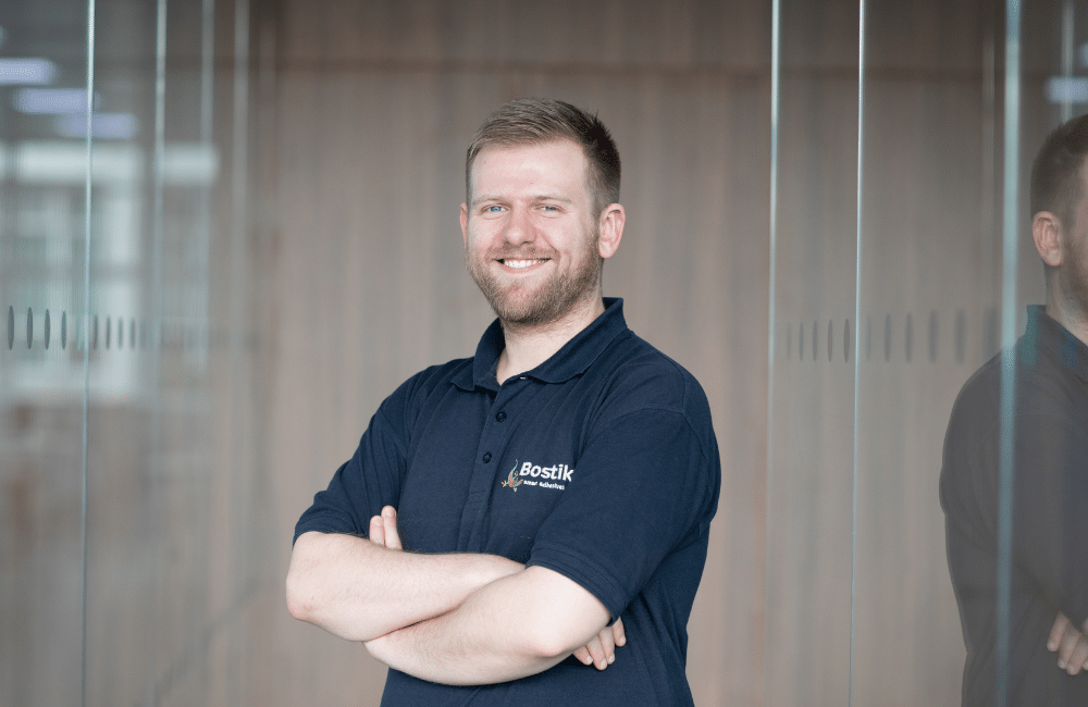 image of Adam Jones, technical sales consultant at Bostik, standing with his arms crossed.